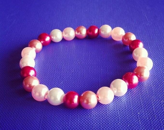 4 shades of pink beaded bracelet