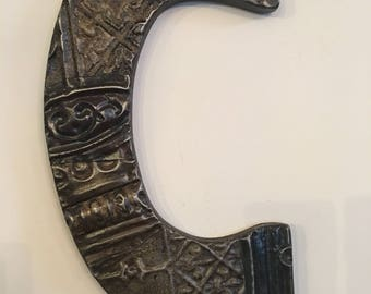 "Patchwork letter ""C"" designed with antique tin ceiling tile"