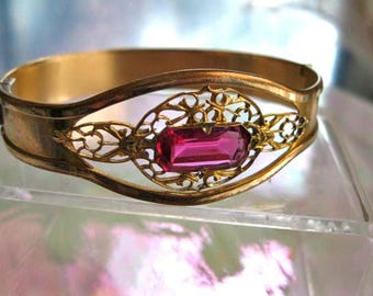 Vintage Bracelet Hinged Golden Cuff, Faceted Glass Deep Rose Pink Lozenge Stone. Lacy Open Gold-Plated Setting, Side-Hinge Closure