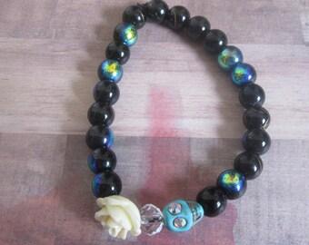 Aqua Skull with Sparkle Eyes Beaded Stretch Bracelet with Carved Rose
