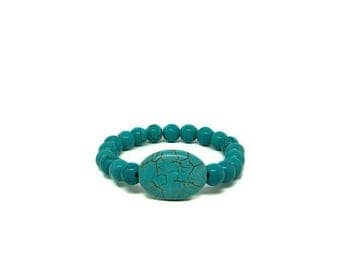 ON SALE Turquoise stretched bracelet with large oval center stone