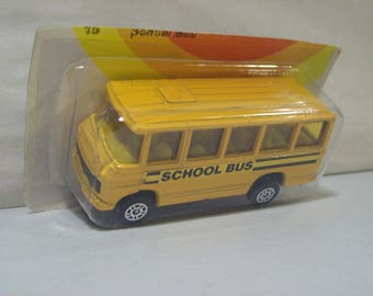 Vintage Corgi Juniors Die-cast Yellow Mercedes Benz School Bus, Great Britain, 1/64 Scal, 1978, On Card Bottom
