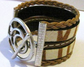 Zebra, braided, leather stitched Brown bracelet, spiral clasp toogle