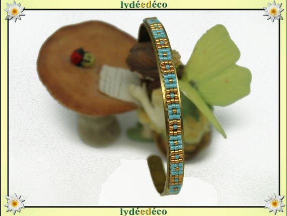 Bangle is 6mm turquoise blue and gold gilt brass and glass Japanese beads weaving