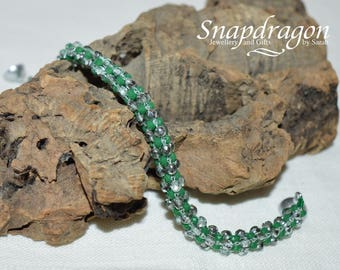 Cubic right angle weave bracelet in green rondelles and faceted sparkly silver and clear beads.