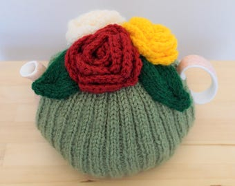 Knitted Green Flower Tea Cosy, light green with red, white and yellow flower tea cosy, tea cozy,