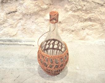 Vinegar bottle with braided wicker