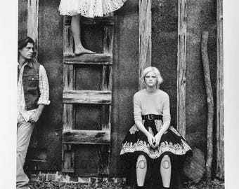 Young people by barn contemporary art fashion photo