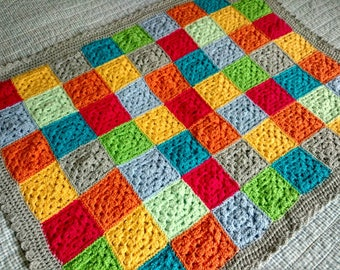 Hand made crocheted baby blanket featuring bright coloured granny squares with a silver edging 86x68cm/34x27inches