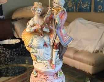 Antique Capodimonte lamp featuring male musician with female