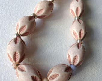 Necklace - pale pink carved plastic large beads necklace