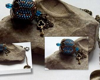 bronze and blue beaded Ball pendant