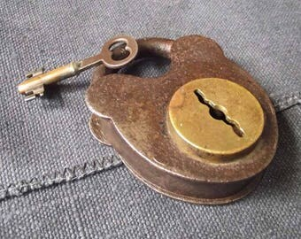 Antique lock with iron body and brass center disk