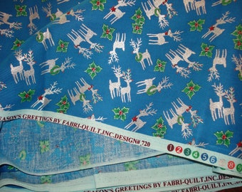 One Piece 2 1/2 yards 44 inch wide Seasons Greetings by Fabri quilt Inc. Design #720 Silver Reindeer on Blue Background