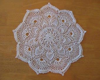 New ecru hand-crocheted doily