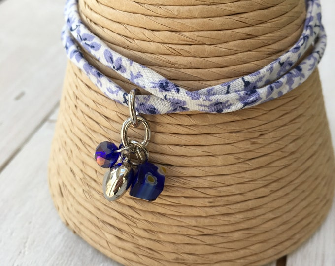 Liberty of London adjustable fabric bracelet with 3 charms including silver tone heart charm.