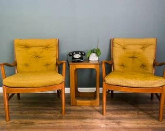 A pair of Parker Knoll armchairs