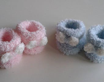Let us put on baby 0 in 12 blue or pink woolen hand-knitted months