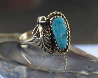 Navajo crafted sterling silver ring with one free form turquoise stone feather 6