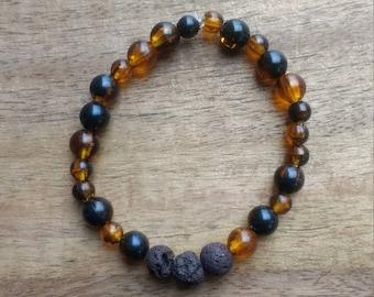 Essential Oil - Brown, Black, and Orange Tones