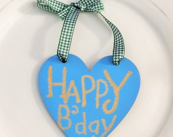Blue wooden Heart Happy Birthday Gift Tag. Gold paint lettering. Forest Green Gingham ribbon ties. Option to purchase Cotton tote gift bag.