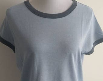 Blue tee with denim coloured neckline and sleeves
