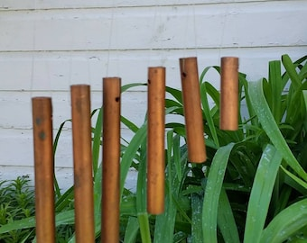 Windchimes from copper piping and wood from Ewekneek Enterprises