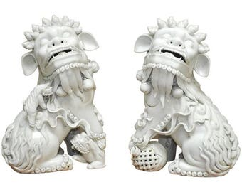 Pair of Chinese Dehua Blanc de Chine Porcelain Foo Dogs