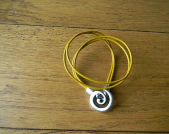 Antique silver spiral closure mustard yellow leather bracelet