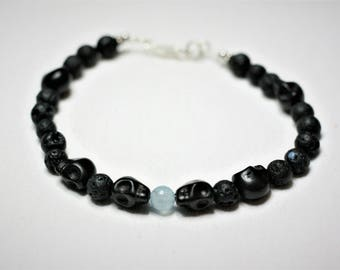 "8 1/2"" Lava rock and howlite skulls"