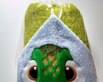 Hooded towel with turtle peeker.