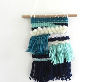 Blue and turquoise wool wall weaving