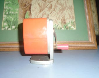 crown vintage pencil sharpener for table orangey red couler
