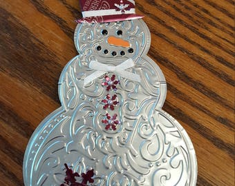 Snowman made from a Cherry Coke can