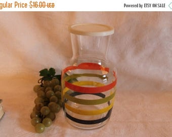 SALE Vintage Striped Glass Juice Carafe with Plastic Lid - Orange, Green, Yellow, and Black Stripes