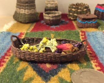 Miniature hand woven oval flat basket