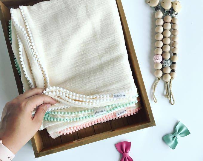NomiLu Confetti Swaddles - Ivory Mulsin Pom Swaddles - Cotton Muslin Gauze Swaddle Blanket