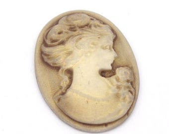 resin cameo depicting a woman's head