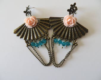 BUCKLES of ears range bronze decorated with a pink flower nail