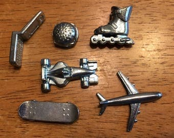 Game Pieces from Electronic Monopoly, 6 Game Tokens, 13 Silver Hotels, and 35 Blue Houses