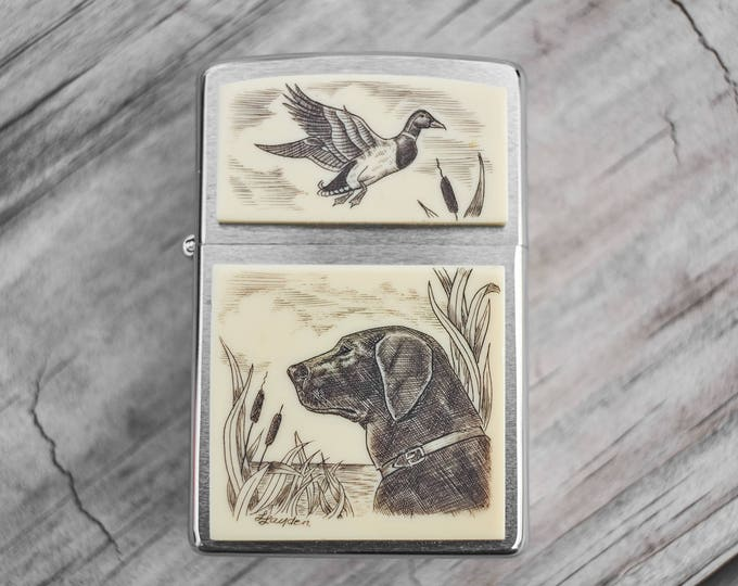 Scrimshaw Zippo with dog and duck by artist Linda Layden rare unfired