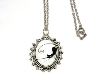 Silver necklace black cat stretching