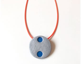 Complimentary colors - blue and gray pendant on orange rubber necklace - handmade with polymer clay and rubber