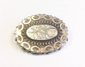 Antique, Victorian, Sterling silver and gold sweetheart brooch with roses.
