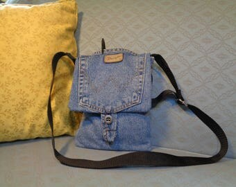 Denim bag, cross body strap attached at sides. Sewn from recycled Wrangler jeans. Pocket and fully lined.