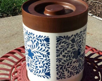 Alladinware floral canister with faux wood lid. 1970's. Plastic