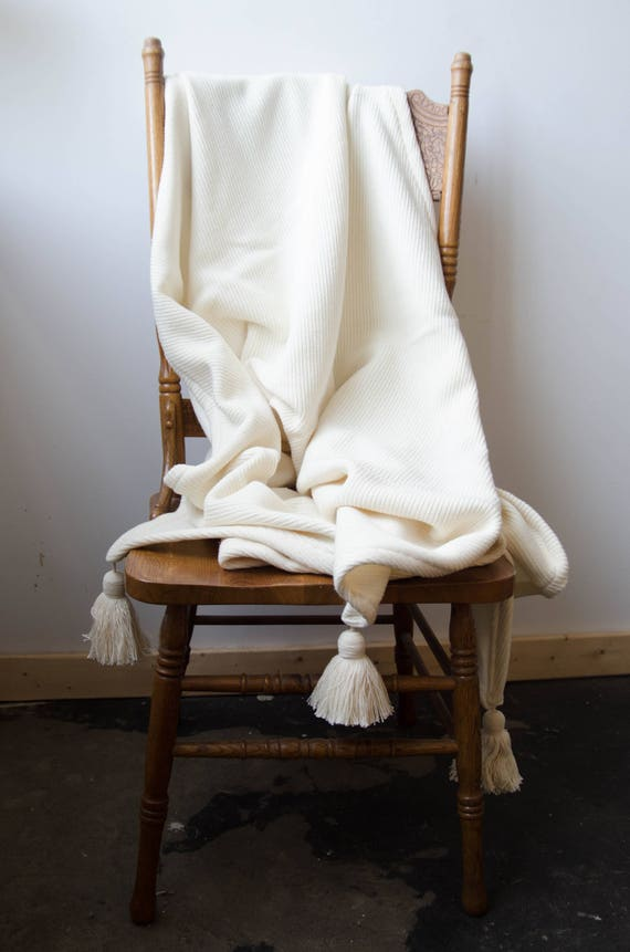 White blanket with tassels
