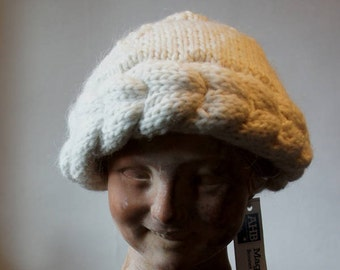 """""""Magic of the wool"""" collection: unbleached white wool twist Cap"""