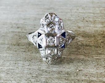 18k sapphire and diamond shield ring