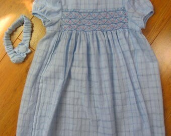 Little girl's blue smocked dress with matching headband and flower decoration for 4-5 years old.
